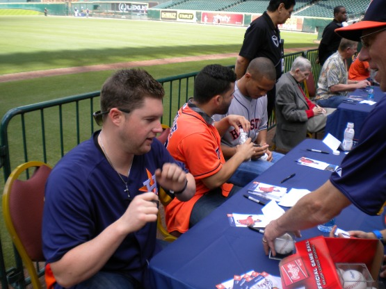 Bud Norris, Jose Altuve and Justin Maxwell sign autographs