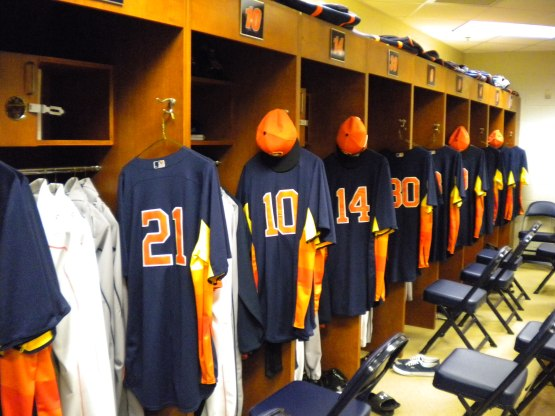 new uniforms hung neatly in lockers.