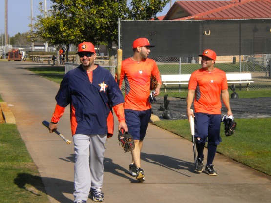 Venezuelans Javier Bracamonte, Jose Altuve and Marwin Gonzalez return from cages.