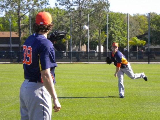 John Ely plays catch with Brett Oberholtzer.