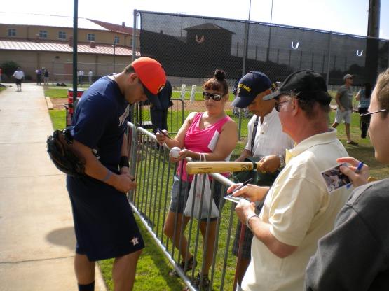 Brandon Laird signs an autograph.