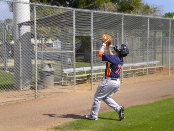 Catcher Chris Wallace chases a pop up.