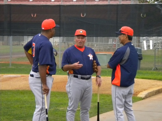 Third base coach Dave Trembley is always smiling as he is here talking with Dave Clark and Dennis Martinez.