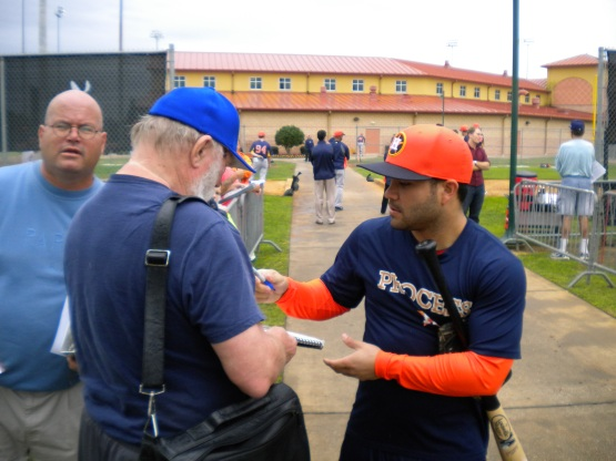 Jose Altuve signs an autograph.