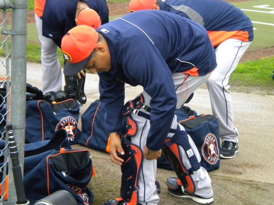 Catcher Rene Garcia puts on his gear.