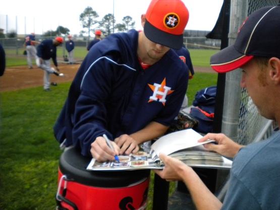 Ross Seaton signs an autograph.