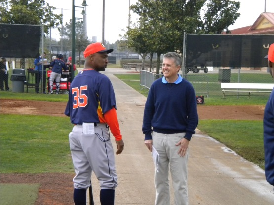 First base coach Dave Clark and GM Jeff Luhnow talk.