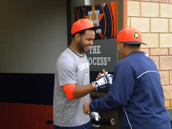 Rene Garcia greets shortstop Jonathan Villar.