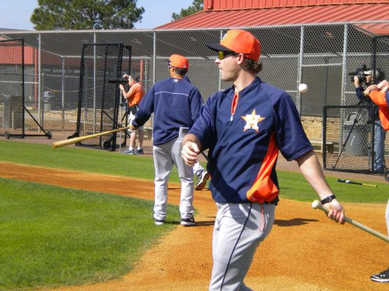 Former Astros SS Adam Everett, an infield instructor, hits grounders.