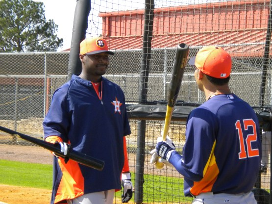 Chris Carter and Carlos Pena talk at the cage.