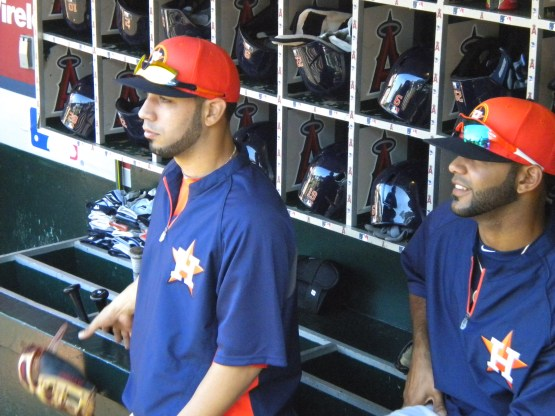 Marwin Gonzalez and Jonathan Villar watch Lucas Harrell juggle.